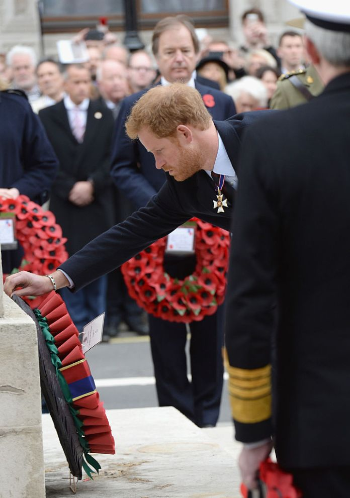 Prince Harry is pictured laying a wreath at the cenotaph in 2016