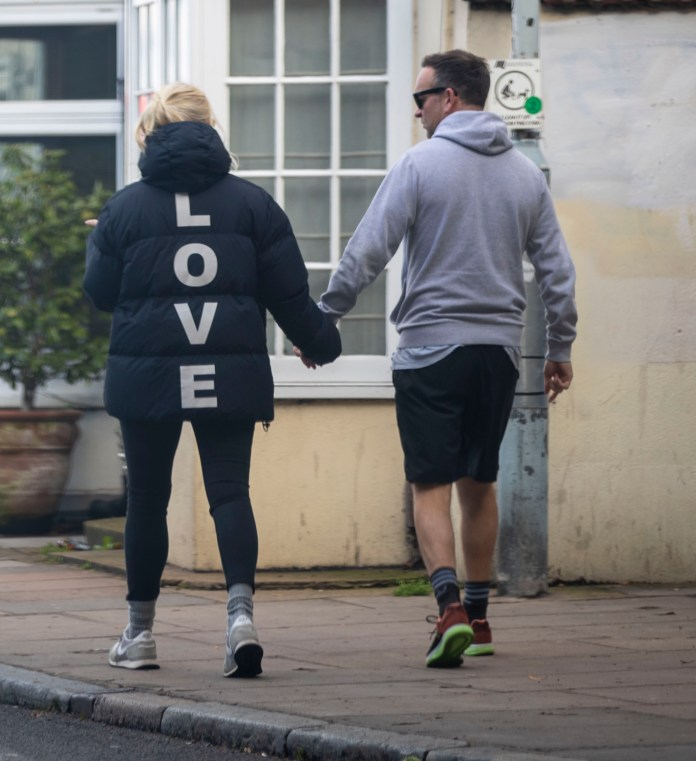 The pair were seen holding hands as they wore a jacket with 'LOVE' on it
