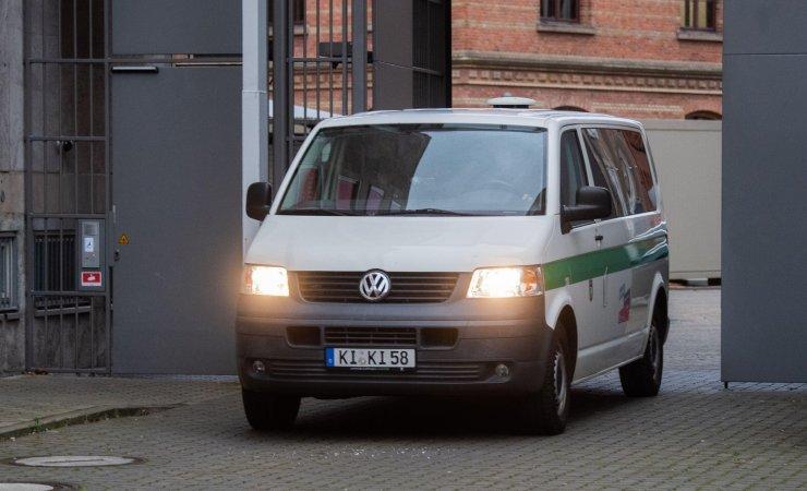 A prison van carrying Christian B arrives at Braunschweig regional court today