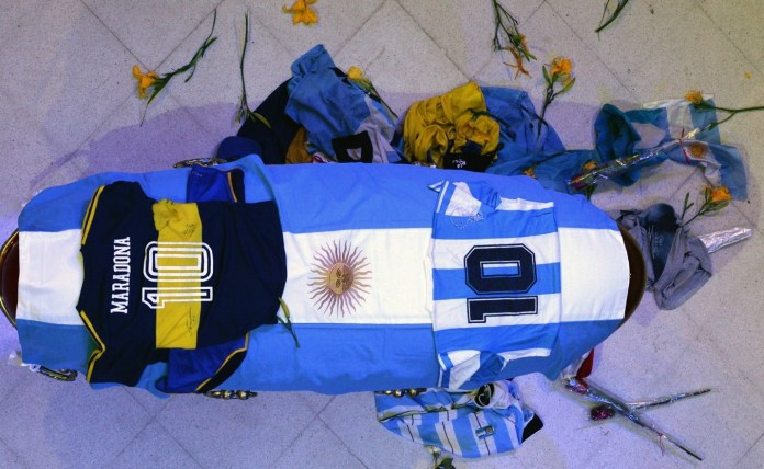 The coffin had swimsuits with the famous Maradona number 10 on it