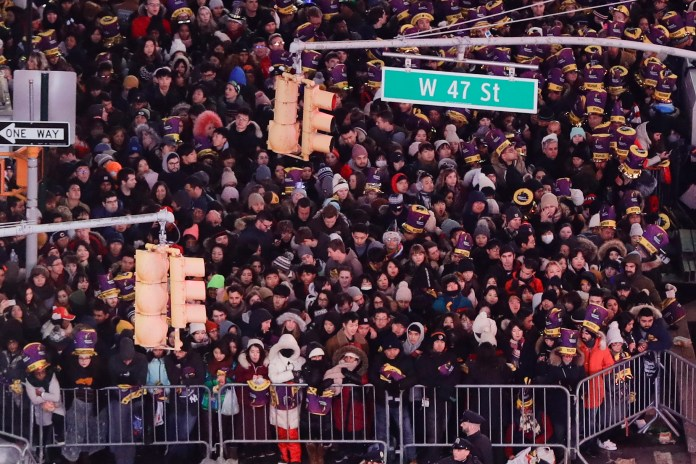 Revelers wait for midnight during the New Year's Eve celebration in New York's Times Square last year