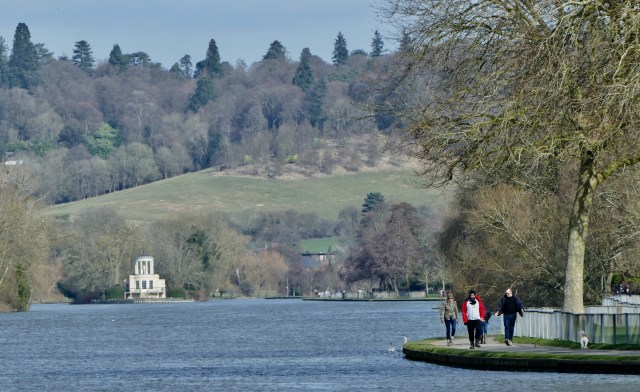 People out and about enjoying the sunshine along the Thames Path in Henley on Thames, Oxfordshire