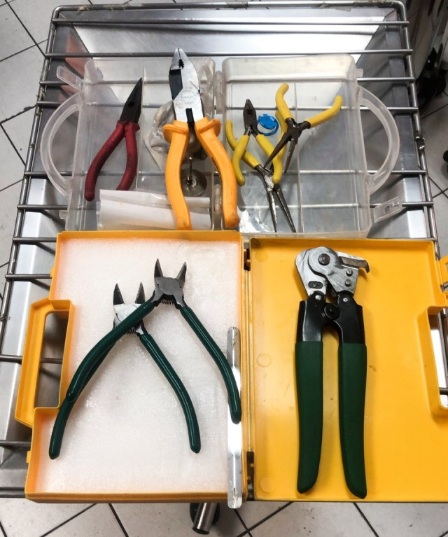 Pliers and bolt cutters laid out in the operating theatre