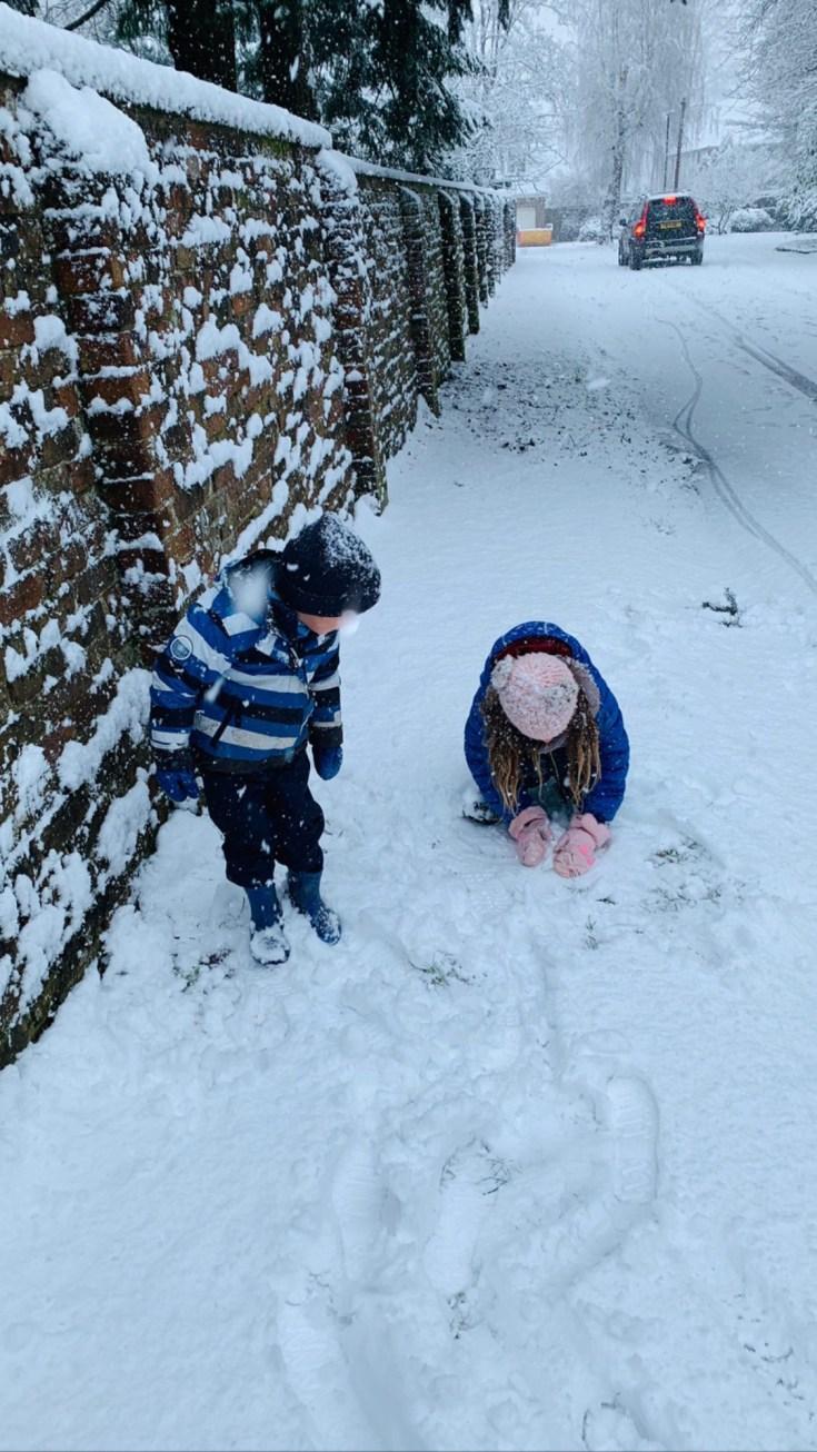 Theo and Amelia enjoying the snow