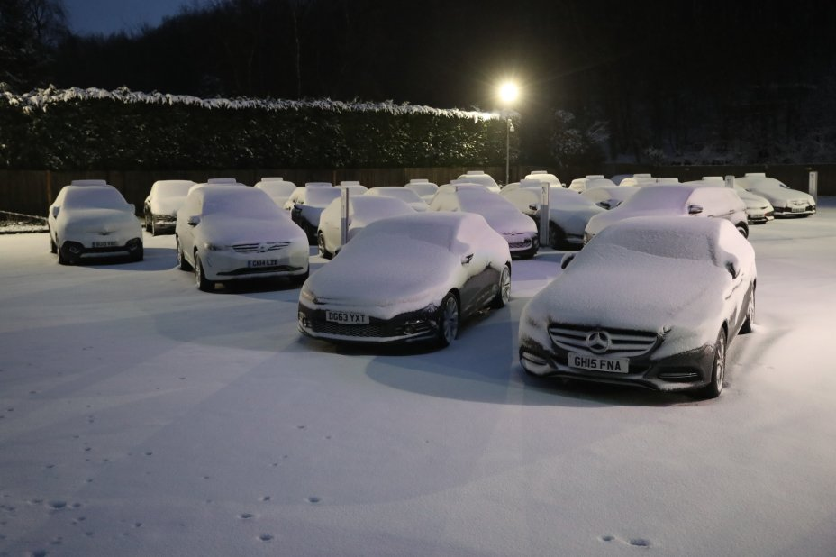 Cars at a showroom near Detling in Kent were buried under thick snow