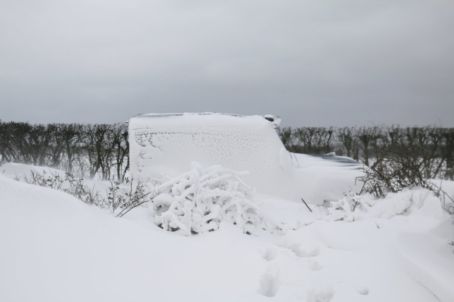 In Orford, Suffolk, two Land Rovers were abandoned overnight on a road after heavy snow blanketed both vehicles