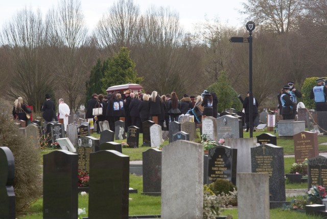 Mourners at the graveyard earlier today