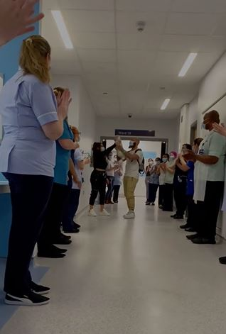 Hospital staff gathered to cheer the little girl on