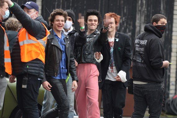 The cheeky lads posed for the camera while filming