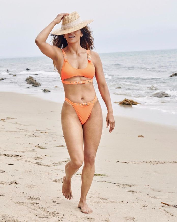 Berry shows off her amazingly fit body in this orange bikini