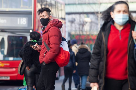 Social distancing and face masks could be part of Brits' lives for years to come