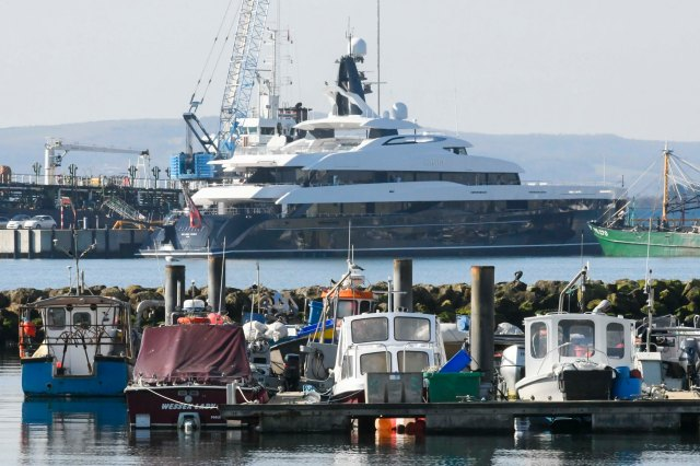 The 240ft long vessel, which has won awards for its stylish design, towers over other boats in the harbour
