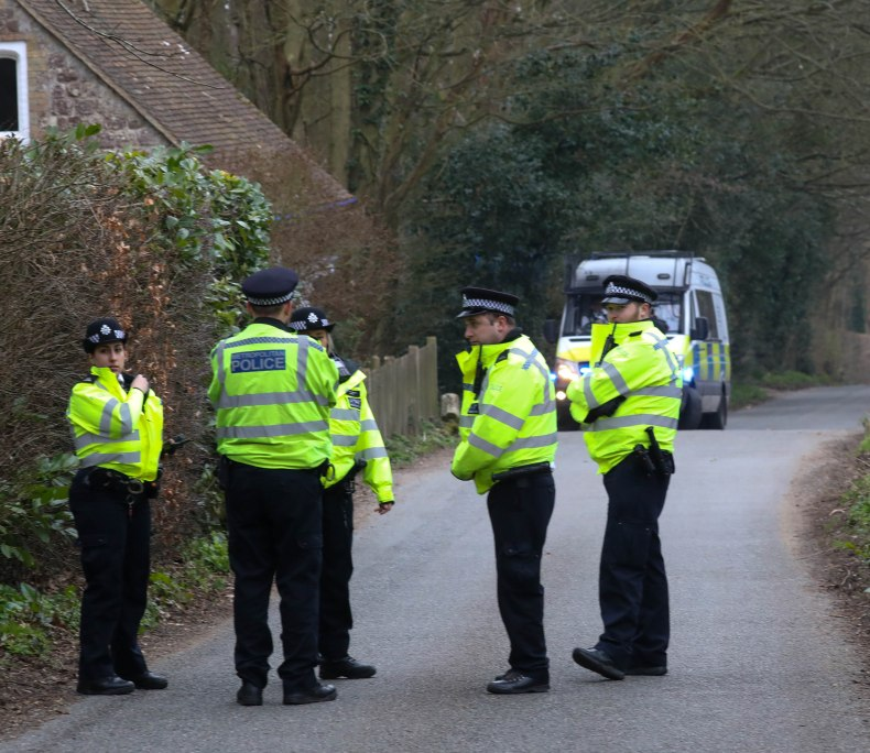 A woman has also been arrested on suspicion of assisting an offender