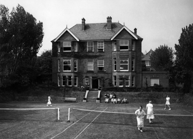 The students played tennis on the back lawn of the finishing school