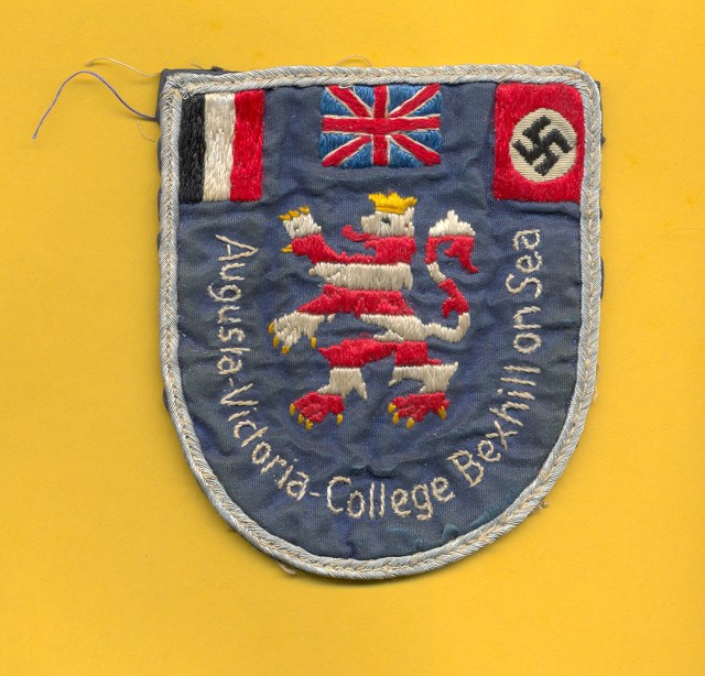 The school's badge featured the Union Jack, German Imperial flag and the Swastika