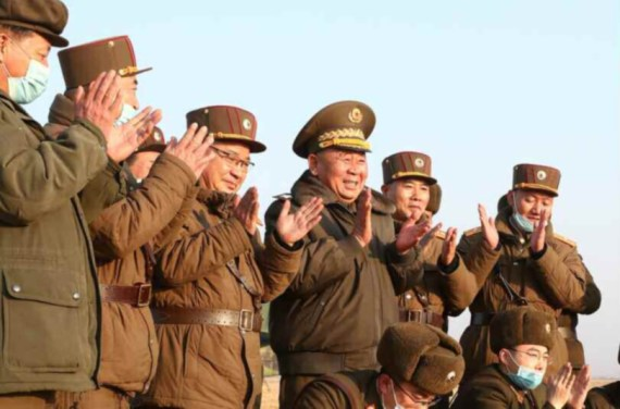 The regime's generals are seen laughing and clapping during the weapons test