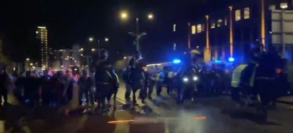 Fireworks were thrown at police as they charged on horses throughout the city
