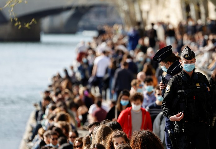 French cops kept an eye on the crowds gathered on the banks of the Seine