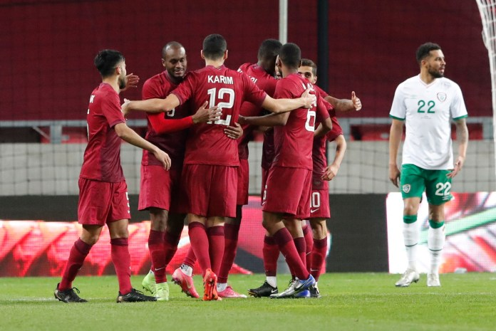 Mohammed Muntari is mobbed by his Qatari team-mates after equalising
