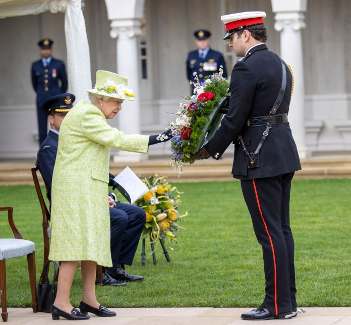 During the service the Queen's equerry Major Tom White laid a wreath on her behalf