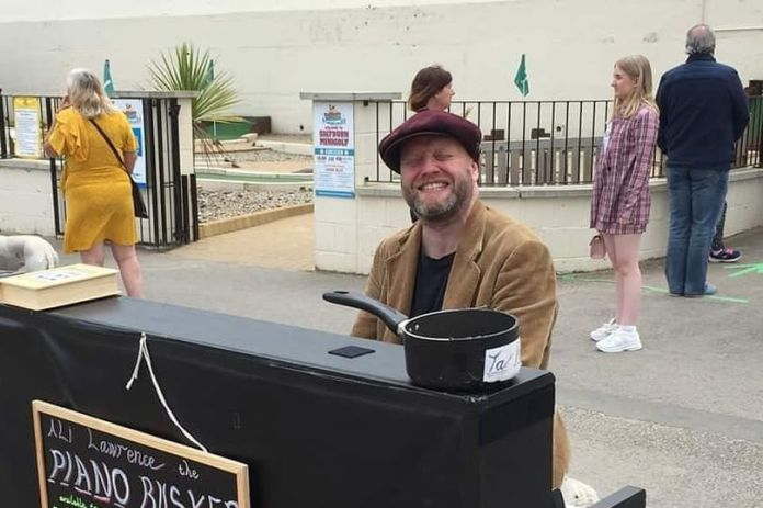 Pianist Alistair Lawrence busking in York city centre