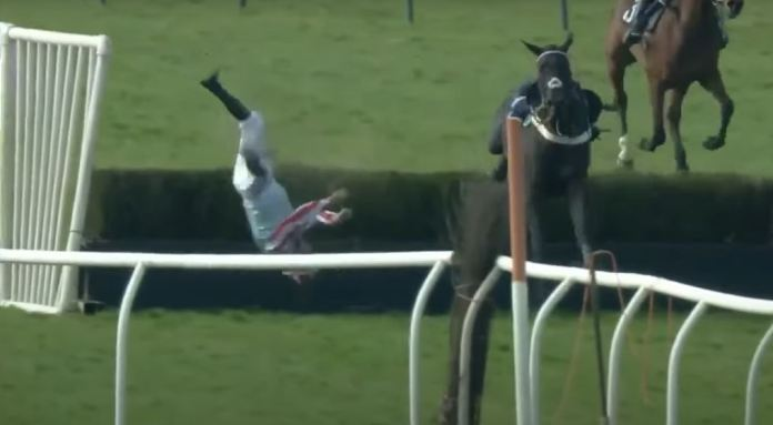 The jockey was flung upside-down over the hurdle in the dramatic fall