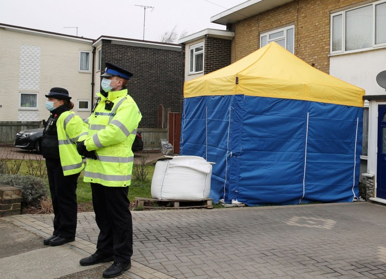 A forensic tent can be seen outside a home in Kent as police investigate