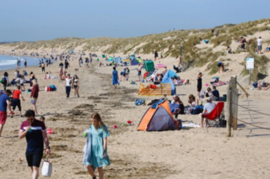 Lots of people were out and about at Camber Sands in East Sussex today, soaking in the unseasonably warm weather