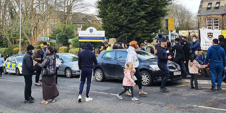 Messages on social media urged people to gather outside Batley Grammar School in West Yorkshire