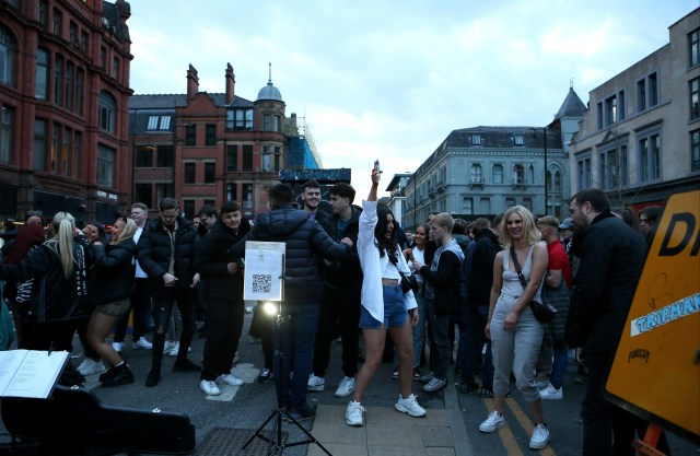 Revellers dance in Manchester this evening