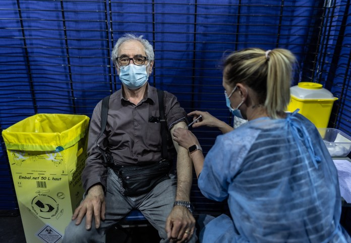Man receiving Pfizer vaccine in France