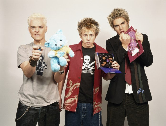 Matt, left, in 2003 with Busted buddies James Bourne and Charlie Simpson