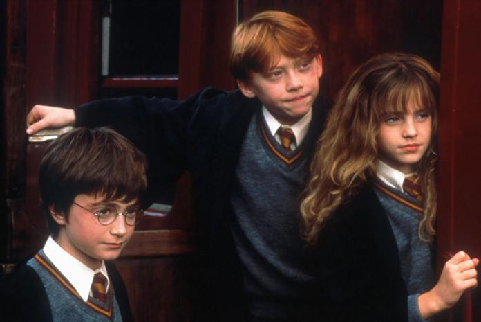 Daniel Radcliffe (left) as Harry Potter, Rupert Grint (centre) as Ron Weasley and Emma Watson (right) as Hermione Granger