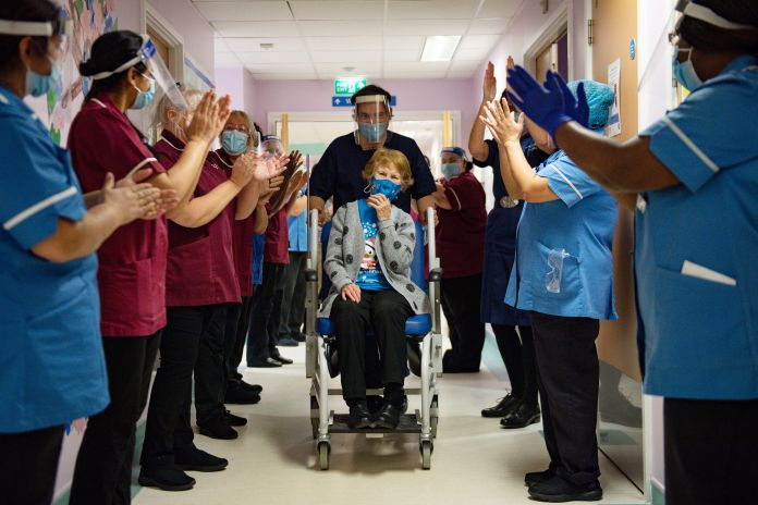 Margaret Keenan, the first person in the world to receive a Covid jab, was clapped by overjoyed NHS workers in December