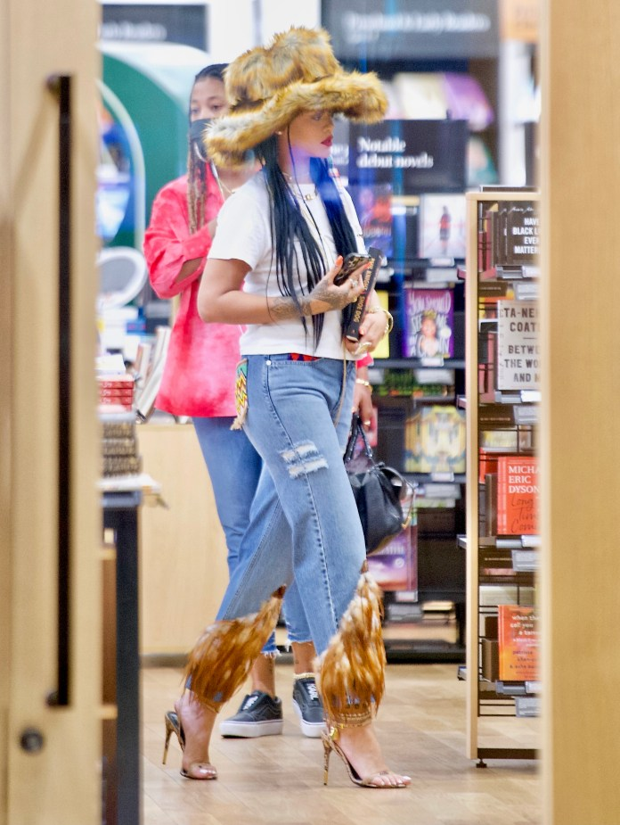 The superstar was shopping with best friend Melissa in LA