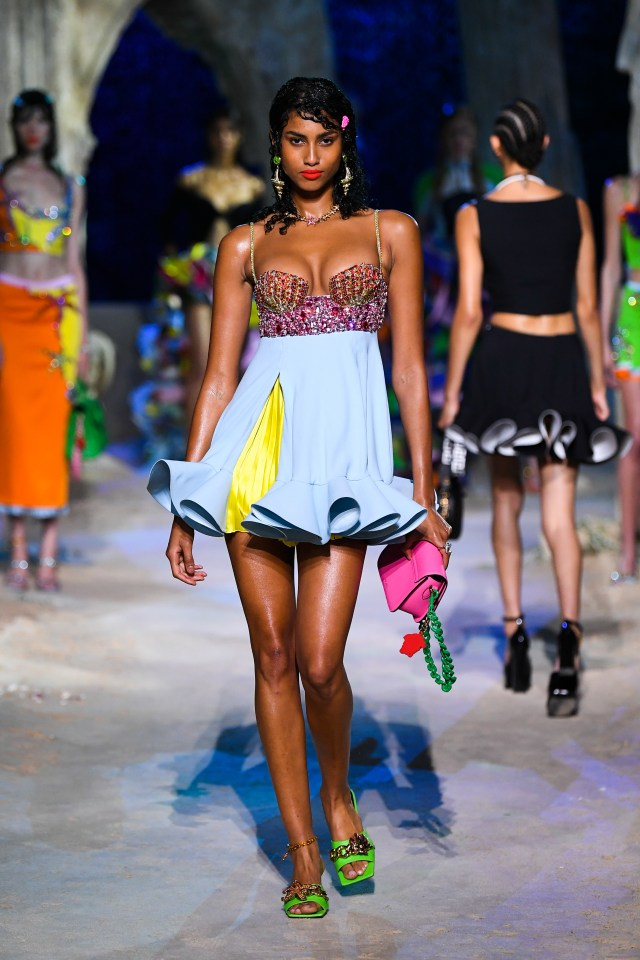 Imaan struts her stuff on the runway at the Versace fashion show in Milan