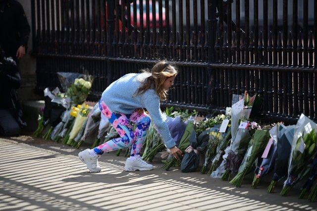 Flowers laid at the gates of Buckingham Palace