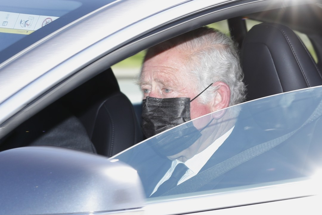 Charles wore a face mask as he headed into Windsor
