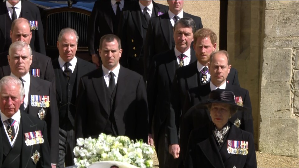 Prince Harry and Prince William walking apart behind their grandfather's coffin