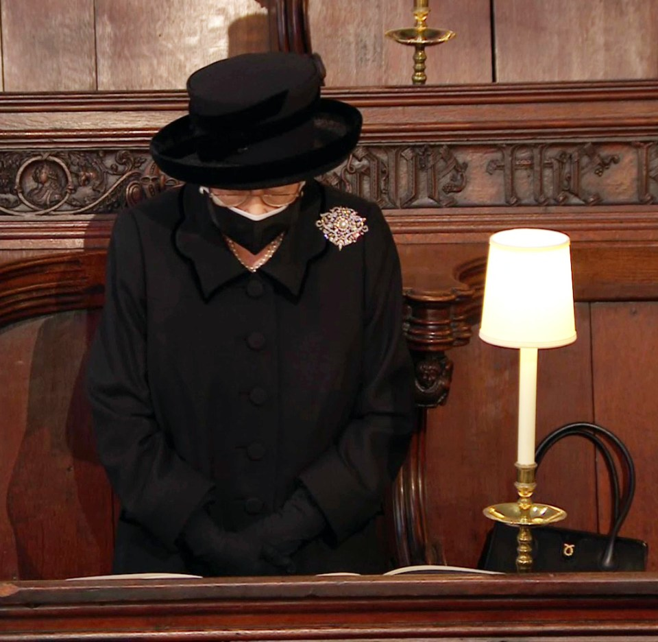The Queen standing with her head bowed at the start of the service