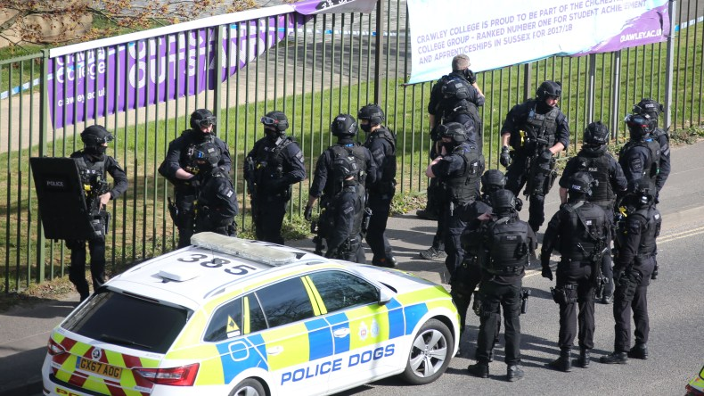 Cops rushed to the scene in Crawley this afternoon