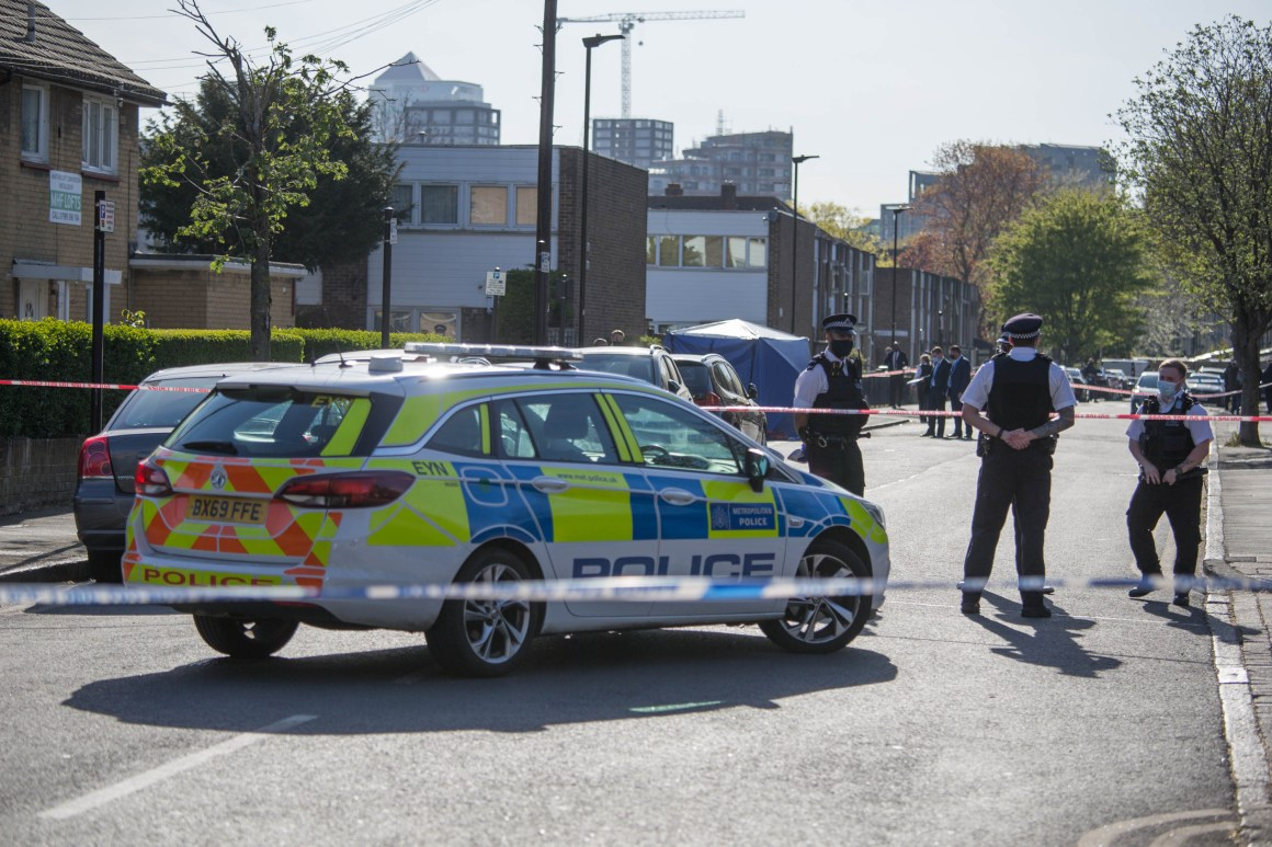 Junior was stabbed to death in Canning Town. Cops are pictured at the scene on Monday