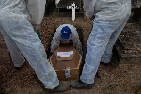 The Brazil variant could spread twice as fast as older strains and could also be twice as lethal. Pictured: The body of a Covid victim is buried at the Inahuma cemetery in Rio de Janeiro, Brazil, April 28