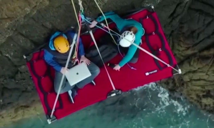 Call centre worker Jason Griffin did a shift dangling off the side of a cliff face