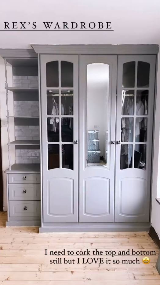 The grey cupboard now matches the rest of the room