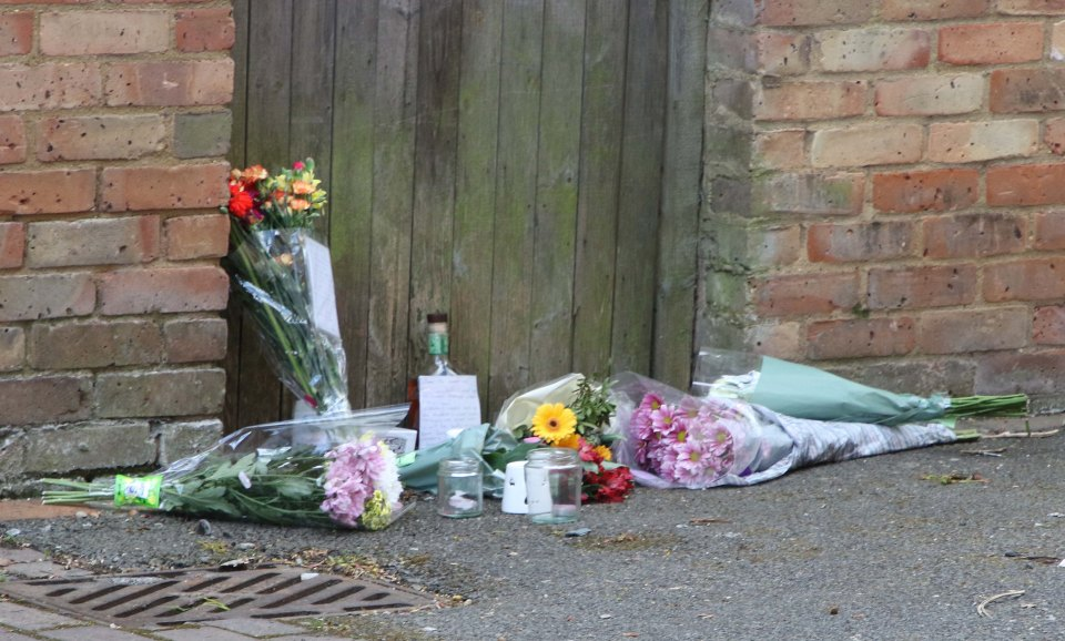 Tributes were left at the scene yesterday