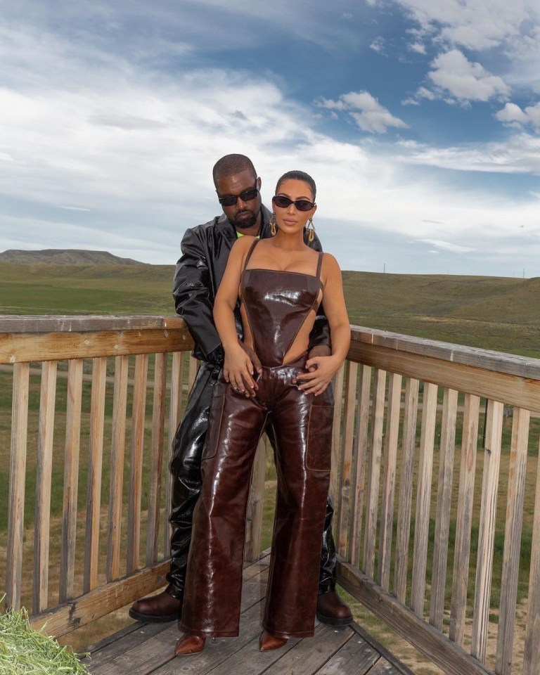 Kim Kardashian wore a matching bodysuit and trousers complete with leather boots