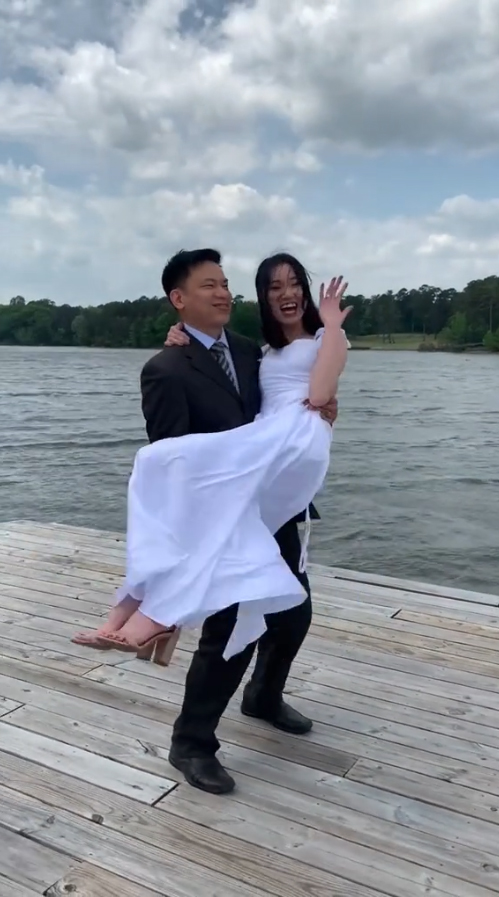 The happy couple celebrate after their wedding