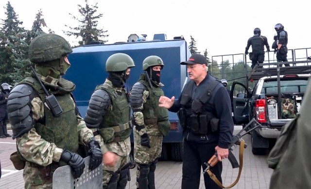 Alexander Lukashenko greets riot police officers on August 23 last year
