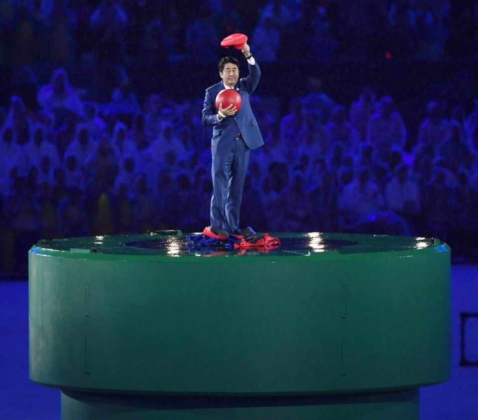 Japanese prime minister Shinzo Abe with a Mario cap during Japan's entrance at Rio 2016 Olympic games
